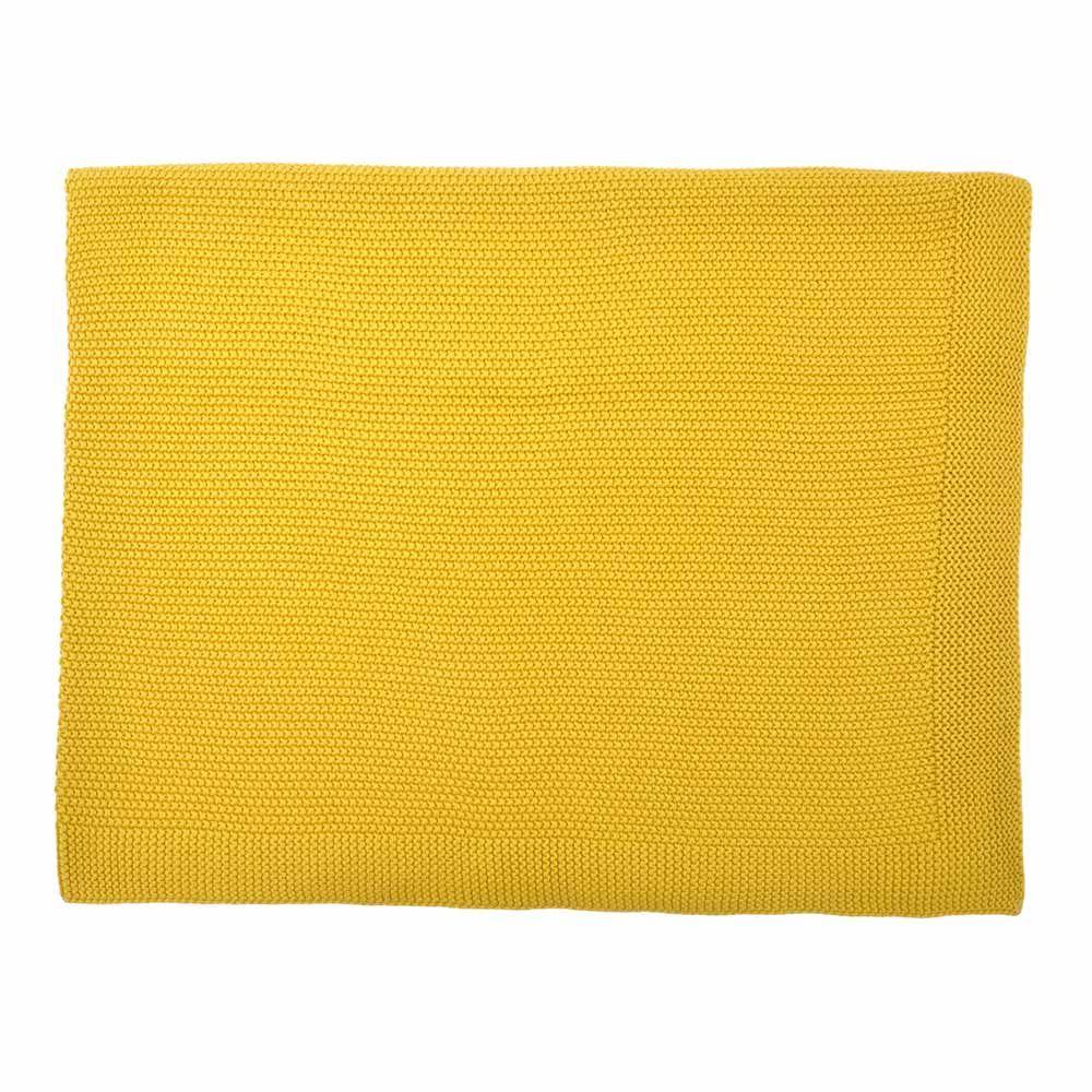Couverture en tricot jaune